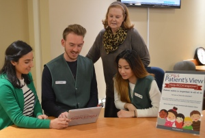 Pat Gillis, Manager, Volunteer Resources, with Patient's View volunteers learning how to use the new iPad survey tool.