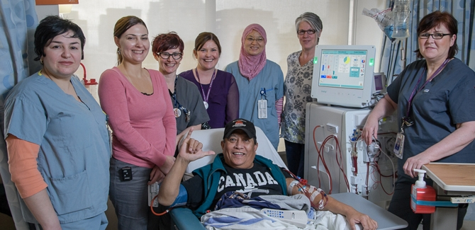 The St. Paul's Renal Program team with Michele Trask, Operations Leader (second from left) and a dialysis patient.